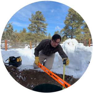 David preforming a septic inspection at a residential home.